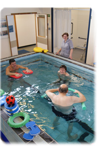 Therapists with patients in our rehabilitation pool